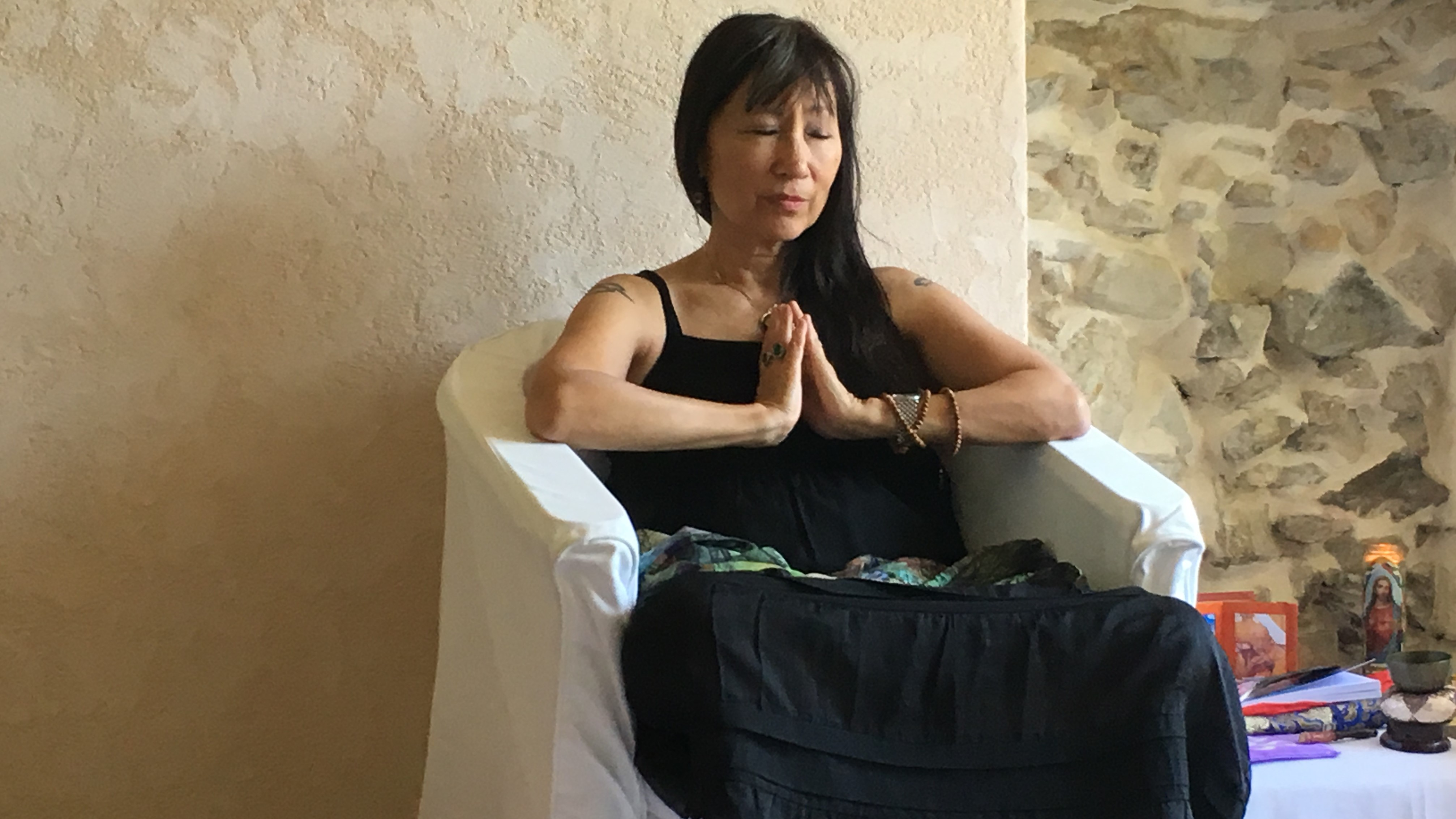 Dr. B. Raven Lee sitting in meditation.